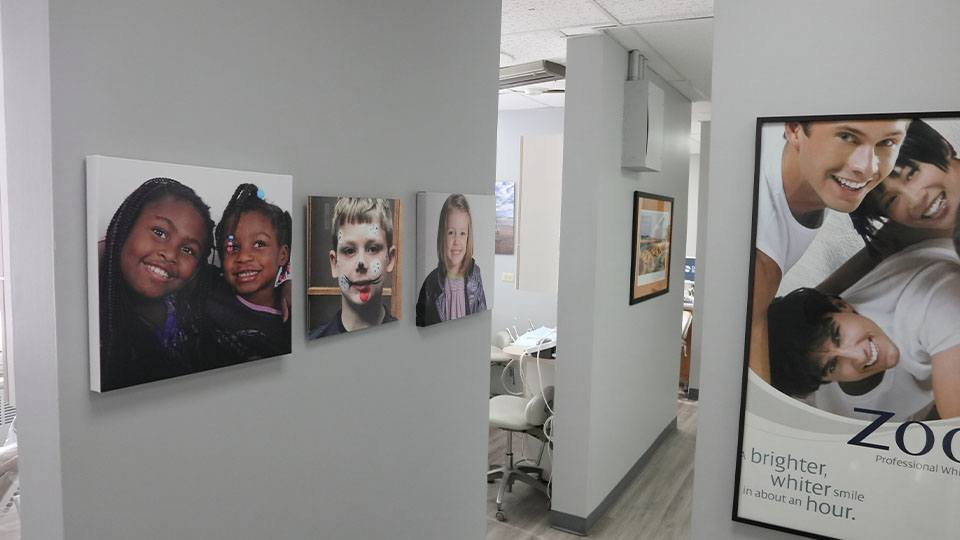 Dental patient images on hallway wall