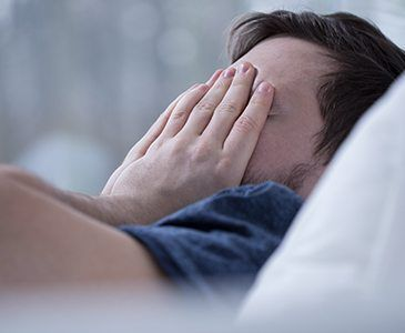 Man in need of sleep apnea therapy waking feeling frustrated
