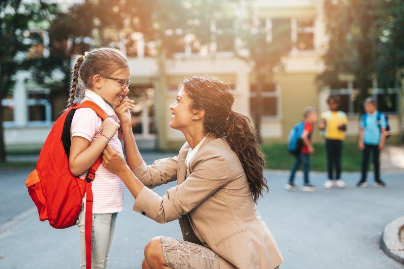 Mother sending child to school after visit to children's dentist